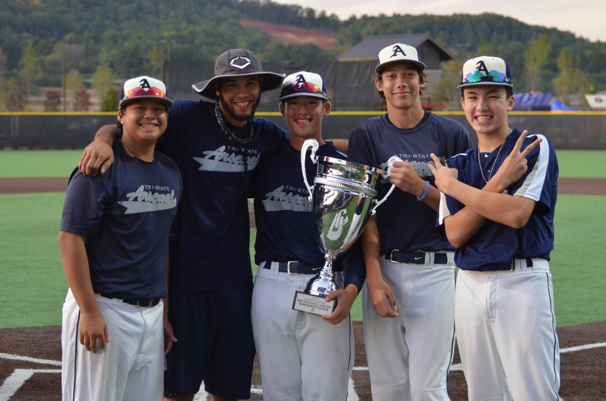 Ryan (far left) with his Tri-State Arsenal teammates celebrating their championship